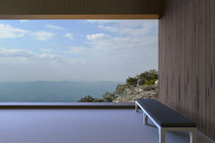 Simple modern rooms and wooden walls and a Chair in the corner window view, the high mountains and the clear blue sky Royalty Free Stock Photos