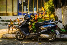 Simple Motorcycle Parked In Side Street. Simple dark blue motorcycle parked in a street at bright autumn day. Photo taken at: 2017-11-07 stock photo