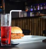Simple. My chicken burger with red Fanta for the stock photos