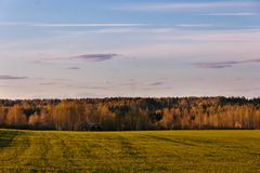 Abstract natural background. Spring field, forest and village stock photography