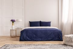 Simple navy blue and white bedroom interior design.  stock image