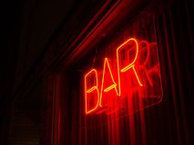 Neon Bar Sign. Simple neon bar sign in a window at night royalty free stock images