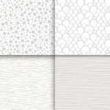 Simple neutral monochrome seamless patterns set Royalty Free Stock Images