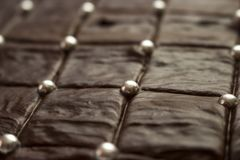 Delicious looking brown chocolate cake with silver sugar balls royalty free stock image