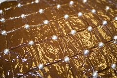 Delicious looking brown chocolate cake with silver sugar balls royalty free stock photography