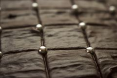 Delicious looking brown chocolate cake with silver sugar balls stock photos