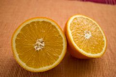 Delicious looking juicy halves of oranges on the table royalty free stock images