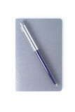 Simple note book with pen. Clipping path. Royalty Free Stock Photo