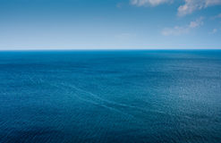Simple ocean horizon. In blue stock images
