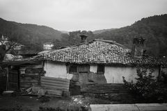 B&W Simple old and abandoned house. Simple old and abandoned house made of mud, straw and stone, monochrome Stock Photography