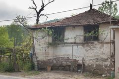 Simple old and abandoned house. Made of mud, straw and stone, monochrome Royalty Free Stock Photo