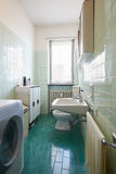 Simple, old bathroom in normal apartment Stock Images