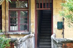 Simple and old residence, door, window and stage. Door and stage of simple and old residence, shown as quite and peace life in a simple life Stock Photography