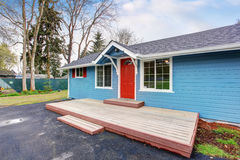Simple one story house exterior with blue and red trim royalty free stock images