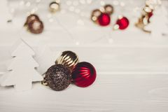 Simple ornaments and christmas trees  on white wood with lights Stock Photos