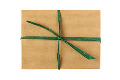 Simple parcel in brown paper with green ribbon Stock Photo