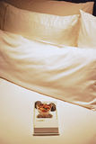 Simple peanut & truffle chocolate snack served as a token of appreciation on luxury hotel king sized bed Stock Photo
