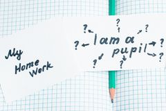 Simple pencil and inscriptions in English on an open notebook Stock Image