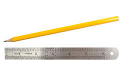Simple pencil and ruler. On white background Royalty Free Stock Photography