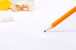 Simple pencil on white paper closeup Royalty Free Stock Images