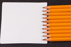 Simple pencils, a blank sheet Stock Photography