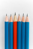 Simple pencils, one red among the blue Stock Photos
