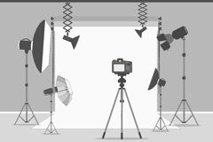 Simple photo studio. White background with lights and cameras Stock Image