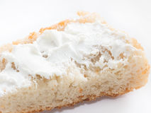 Simple piece of bread with cottage cheese spreaded on white isol Stock Photos