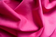 Simple pink fabric in soft folds. Simple pink jersey fabric in soft folds Royalty Free Stock Photography