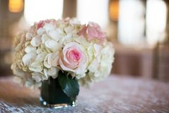 Simple Pink and White Rose Vase Table Arrangement Stock Photo