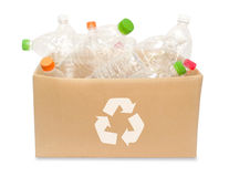 Plastic bottles in a box. Simple plastic bottles in a box with recycle sign Stock Image