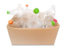 Plastic bottles in a box. Simple plastic bottles in a box on white background Stock Photo