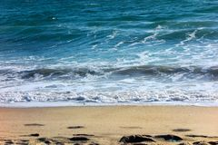 Simple Pleasure of Wet Sand and Noisy Waves Stock Image