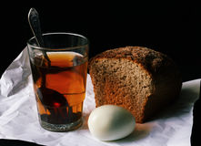Simple and poor food. Photo symbolising simplicity and poverty. Here is a simple food: bread, egg and tea royalty free stock images