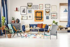 Free Simple Posters Gallery Hanging On The Wall In Bright Living Room Stock Image - 156159041