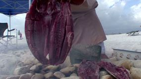 Simple preparing a fish for lunch Omani way stock video footage