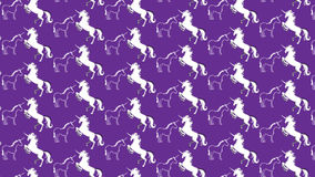 Simple purple background with some unicorns Royalty Free Stock Photography