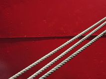 Simple red. Ropes on red stock image