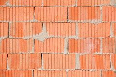 Simple red brick wall with mortar usable as texture Stock Image