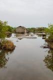 Simple reed mat homes of poor fishermen in wetlands of Benin. Africa Royalty Free Stock Photos