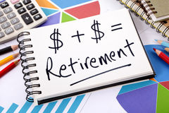 Retirement pension fund growth concept, plan. Simple retirement formula written on a notepad surrounded by graphs, charts, calculator, books and pencils Stock Photo