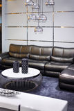 Simple room with black leather sofa royalty free stock images