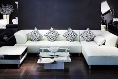 Simple room with white sofa, small magazine table Royalty Free Stock Photos
