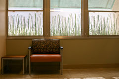 Simple room with wide chair and side table Royalty Free Stock Photography