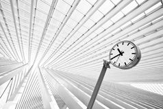 Simple round clock in futuristic interior Stock Photo