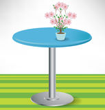 Simple round table with flower Stock Photography
