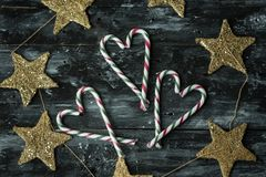 Simple rustic Christmas background with canes and golden stars royalty free stock photos