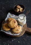 Simple rustic homemade cookies with dried figs and raisins and greek yogurt on a wooden cutting board Royalty Free Stock Photos