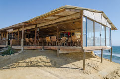 Simple and rustic lodge right at the ocean in Angola. `s Namibe desert. Great view from huge window and open sided building Stock Images