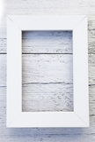 Simple rustic white frame and textured background. Simple empty rectangular rustic white frame and textured rough painted wooden background with copyspace for Stock Photography